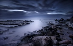 n e v e r l a n d (Noval N | Photography) Tags: longexposure blue cloud seascape rock sunrise landscape moody cloudy sydney australia nsw
