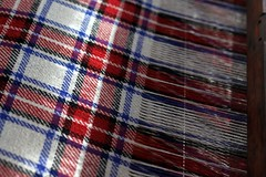 At the weaver's loom (keith bissett) Tags: uk blue red white scotland check colorful pattern unitedkingdom traditional machine lewis scottish fabric harris colourful woven westernisles weaving weave loom hebrides shallowdepthoffield shallowdof harristweed canonslr tweel crofter twill canon50mmlens clothmaking canonprimelens