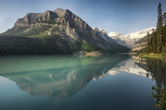 Early morning light on Lake Louise (wimvandemeerendonk) Tags: morning light wild sun lake canada color colour reflection tree green colors rock contrast outdoors dawn rocks colours bright sony ngc alberta banff lakelouise bej abigfave diamondclassphotographer wimvandem 650699faves