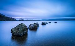 The Haunting Idle (rgcxyz35) Tags: natioalpark scotland water lomondtrossachs clouds lochlomond lochs longexposure milarrochybay rocks