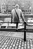 Bristol; December 2016 (Daniel Durrans) Tags: leg rail man back street bristol boats streetphotography boat harbourside railings harbour urban