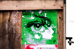 locked and boarded green eye (PDKImages) Tags: posterart manchesterstreetgallery manchesterstreetart art artinthecity love walls bee doorways men eyes wall mural couple industrial hidden beauty message hiddenart urbanart