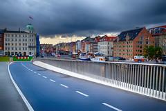 Over the Bridge in Copenhagen, Denmark (` Toshio ') Tags: toshio copenhagen inderhavnsbroen bridge denmark nyhavn clouds history europe european europeanunion scandinavia road street fujixe2 xe2 boats boat harbor city