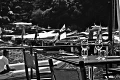 """Restaurant On The Beach In Portofino"" (giannipaoloziliani) Tags: crystal trasparence glasses trasparenza cristallo restaurant monochromatic blackandwhite portofino italy view beach genova sea seaview landscape mare liguria italia vista vistamare spiaggia shapes sagome tables tavoli bicchieri vetro glass perspectives man uomo panorama sunlight sun nikonphoto nikonblackandwhite nikon nikoncamera nikonphotography flickr boats ristorante ristorantesulmare sole"