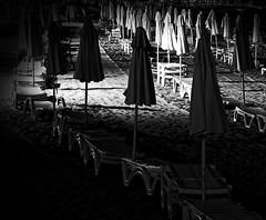 Silent ceremony (Adi Berger Photo) Tags: night blackandwhite bw ceremony nikond300 nikon sand umbrellas chairs