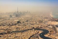 Climbing away from Dubai (TedrickM) Tags: skyline downtown dubai skyscrapers towers uae jet emirates dubaicreek aerialphoto ek unitedarabemirates ae dxb dubaiinternational burjkhalifa ek229