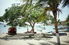 Caribbean (hiphopmilk) Tags: ocean santa sea film beach analog america 35mm de boat town lomo lca lomography colombia ship fuji south canoe marta caribbean analogue sands taganga magdalena dinghy baha 135film jaredyeh hiphopmilk