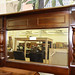 Mahogony ornate frame over mantle