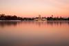 Pink Dawn (mclcbooks) Tags: denver colorado citypark landscape lake longexposure le skyline city boathouse mountains sunrise dawn glow reflection