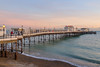 lights-on (Rourkeor) Tags: worthing england unitedkingdom gb pier sea sunset people sky glow waves water sand reflections wooden architecture flags cameras sony sonyrx1r rx1r fullframe carlzeiss zeiss sonnar t 35mm