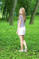 Teenagers Lifestyle Concepts. Full Length Portrait of Blond Caucasian Teenager Girl Posing Outside in Green Forest. (DmitryMorgan) Tags: 1 1319years attractive beautiful blond blondyhair casual caucasian cheerful concept cute day enjoying female forest happy holidays joyful leisure leisureactivity lifestyle lifetime lovely one outdoors park positive relaxing skirt smiling standing stripe stripy stylish summer sunglasses sunny teen teenager vacation white younggirl youth