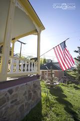 (creationartistcoPHOTO) Tags: nickileemansion centralcity colorado frontporch flag sunlight morning frontyard classic