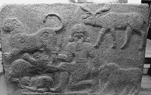 Hittites: Master of animals (Gilgamesh) grasps the hind leg of a lion in one hand, the horn of a bull in the other and is accompanied by a stag and two other beasts, Mythological scene, The Herald Wall's reliefs, Carchemish by Efendi.