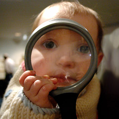 magnified (toyfoto) Tags: magnifyingglass baby museum family