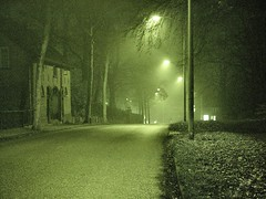 down this road ... (josef.stuefer) Tags: street city urban green netherlands lamp misty fog night danger nijmegen dark movie interestingness streetlamp grain explore crime mysterious infrared noise filmnoir josefstuefer