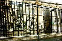 Statue Graveyard (Brenda Anderson) Tags: paris france fence europe louvre statues 1993 contiki scannedprint curiouskiwi brendaanderson curiouskiwi:posted=2005