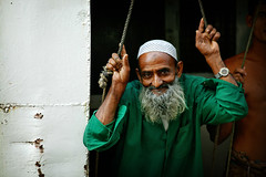hanging out - portrait asia man travel hanging phitar boat bangladesh dhaka out