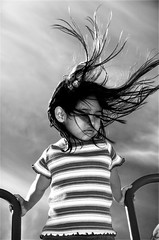 Force of nature (fd) Tags: family portrait sky bw clouds hair topv999 daughter windy 25 topf100 themecompetition cotcpersonalfavorite lightproofboxcom utatafeature tccomp077 tccomp118