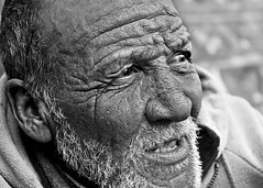 life poetic (stoneth) Tags: poverty sf sanfrancisco california ca street portrait people urban blackandwhite bw 15fav white man black male eye beautiful face closeup 510fav beard person blackwhite eyes nikon day d70 nikond70 homeless poor bald photojournalism streetportrait forsakenpeople social impoverished 2006 1870mmf3545g human grayscale outcaste nikkor 110fav destitute streetshot interestingportrait sftenderloin