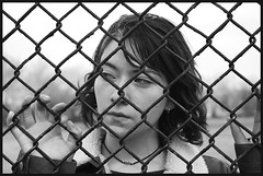Staring Into Space (Serge Arsenie) Tags: camera slr girl fence d50 outside cool nice warm awesome shannon nikkor dslr