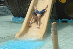 Payton flies down like Superman. (abbedon) Tags: waterslide pirateship payton