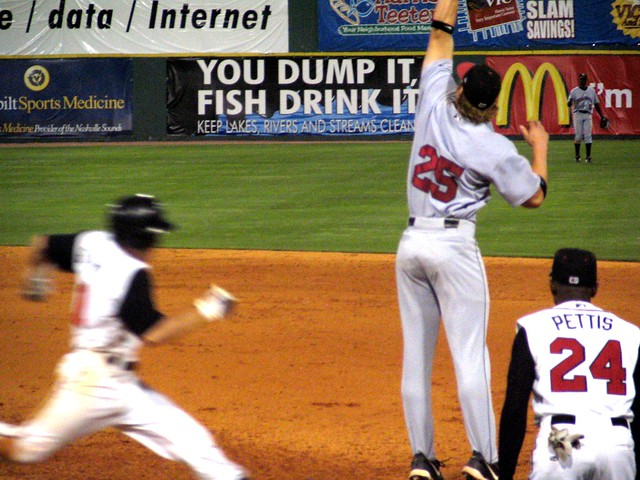 The ball sails above a leaping Jason Botts