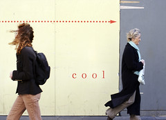 Into the cool (Nad) Tags: street hinge scarf walking point words cool women coat profile right hoarding direction backpack arrow panels dots breeze messageforobama