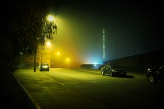on awakening from a coma (ellectric) Tags: road uk blue london cars yellow fog night landscape lights moody lewisham deptford se8 filmformat 1000v40f pepysestate eddystonetower daubeneytower oxestallsroad