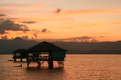 sunset surprise (Farl) Tags: ocean travel vacation orange beach colors bay philippines peach sandbar huts bais negros negrosoriental phototip bluelist baisbay manjuyod