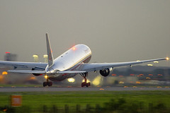 Boeing 777 American Airlines (Greg Bajor) Tags: city uk greatbritain travel sunset red england sky holiday motion france london lines tarmac modern illustration night clouds speed plane sunrise out airplane lights for evening fly flying moving airport wings movement blurry er traffic display unitedkingdom britain dusk heathrow background aircraft altitude aviation air united jets airplanes touch great transport flight wing jet fast kingdom gear millenium blurred down move off aeroplane jfk landing business climbing international journey american commercial depart transportation airline planes arrive take fixed british local boeing arrival airways airports gregory airlines scheme departure baa takeoff 777 runway flights blured atmospheric airliner lhr airliners aerospace flaps rotate taxiing livery silvertown birdlike movingup landings egll runways bajor movingdown aviationart