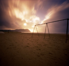 Seaside, Swingset (Zeb Andrews) Tags: film beach beautiful oregon 1025fav wow wonderful square seaside cool nice awesome 100v10f fujireala pinhole pacificocean 2550fav pacificnorthwest zeroimage zero66 bluemooncamera zebandrews zebandrewsphotography