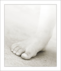 I'm still standing (david_CD) Tags: bw kids children foot stand kid toes child little bokeh walk young highkey losangles solid