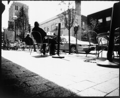 Cafe Tables (Voxphoto) Tags: blackandwhite bw sun table annarbor pinhole papernegative 8x10 sidewalk washingtonstreet cafezola ilfordmultigrade bigpuppypinhole