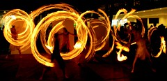 Fireflys (... Arjun) Tags: longexposure 15fav panorama blur night 1025fav 510fav fire movement nikon singapore asia d70s interestingness1 wideangle 2006 panoramic noflash 1870mmf3545g motionblur 2550fav 500v50f poi 50100fav handheld pyro 1000v100f topf150 18mm simei firetwirling topv6666 singaporeartsfestival 1second fireflys onesecond mireasrealm i500 100200fav heroesofthelalaland explore20070704