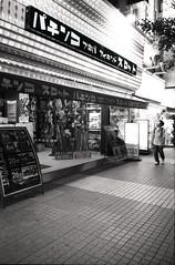 Akihabara #2 (mechanics) Tags: leica city people urban bw white black film japan night tokyo blackwhite asia 28mm rangefinder  push nippon  akihabara neopan mp nihon kanto mechanics chiyodaku urbanlife  presto chiyoda  f19 ultron japaninbw