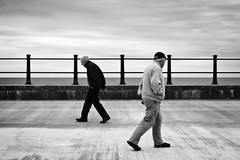 Tramore Walk along the promenade (Pat Kelleher) Tags: street blackandwhite bw blancoynegro noiretblanc pat strangers streetphotography simplicity form shape tension tramore kelleher enblancoynegro patkelleherphotography
