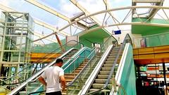 escalation (Harry Halibut) Tags: blue red green glass lift steel south yorkshire curves elevator escalator transport images passenger executive stainless allrightsreserved interchange sypte colourbysoftwarelaziness 2015andrewpettigrew imagesofbarnsley barnsleyarchitecture barnsleybuildings barnsley1507110495