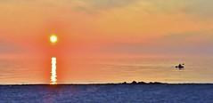 Kayak with setting sun (stevelamb007) Tags: sunset orange sun lake beach nature beautiful clouds nikon kayak michigan lakemichigan sawyer shorewood 18200mm stevelamb d7200