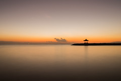 Alone (Thanwan Singh) Tags: ocean morning travel bali orange beach yellow clouds sunrise dark indonesia landscape photography dawn bright hut sanur pantaisanur pantaikarang blackjuice7 thanwansingh