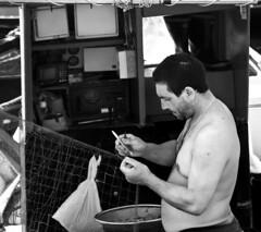 Mending Nets (albireo 2006) Tags: blackandwhite bw italy net blackwhite fisherman italia pb nb bn sicily nets sicilia pescatore favignana rete fishingnet egadi blackandwhitephotos isoleegadi blackwhitephotos egadiislands