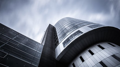 Isolated Vision Series : Helio (Substant Photography) Tags: architecture architectural longexposure nd filter futuristic modern city urban building lookup wideangle design detail fineart facade sky canon clowds munich isolatedvisionseries dark effect geometry germany angle wow