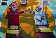 Rock Breaks Scissors (Gary Burke.) Tags: mural painting art people tourism touristattraction vacation travel canon eos 70d dslr canoneos70d klingon65 city garyburke streetart colorful urban citylife wanderlust traveling cityliving pubicart puppet rockpaperscissors game wall bricks brickwall devil god goodvsevil artist montreal quebec canada canadian north ca details fb publicart downtownmontreal stlaurent saintlaurent good evil puppets