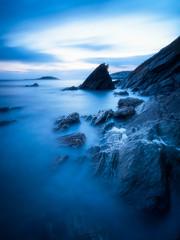 Millendreath Blues (Timothy Gilbert) Tags: 10stop looe sunset panasonic longexposure boulders rocks panasonic1235mmf28x beach millendreath nikcollection blue srbphotographic wideangle cornwall coast gx8 cloudsstormssunsetssunrises