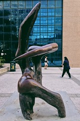 Distractions (Paul Jacobson) Tags: statue sculpture brown steel people passing vsco vscocam