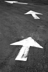 Turn left (James_D_Images) Tags: blackandwhite monochrome parkinglot asphalt pavement direction arrows left graphic cracks