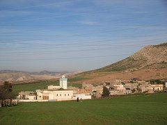 Mosque and village, Highway N4 west of Fez, Morocco (Paul McClure DC) Tags: morocco jan2017 almaghrib fèsmeknèsregion scenery architecture historic mosque minaret