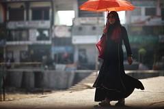 She sure knows how to walk ! (N A Y E E M) Tags: woman umbrella candid portrait light street burqa hijab outerstadium chittagong bangladesh windshield