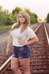 (four-eyed photography) Tags: school portrait woman nature senior girl grass sarah train hair high model jean legs tracks curly blonde shorts 2016 jeansshorts
