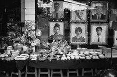 Faces From The Past (35mm) (jcbkk1956) Tags: pictures street blackandwhite film window shop analog 35mm thailand mono photos kodak bangkok rangefinder photographs tables konica manual stools ilford crockery pictureframes kitchenware thonglo photographicshop worldtrekker