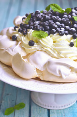 "Cake ""Pavlova"" with blueberry and mascarpone. (lilechka75) Tags: blue summer food white cake fruit recipe table dessert cuisine baking wooden leaf berry natural sweet sauce chocolate background traditional egg australian cream mint dry spoon dressing delicious blueberry eat homemade bakery pastry cocoa russian fragile pavlova tinted meringue filling baked torte whipped brittle cacao"